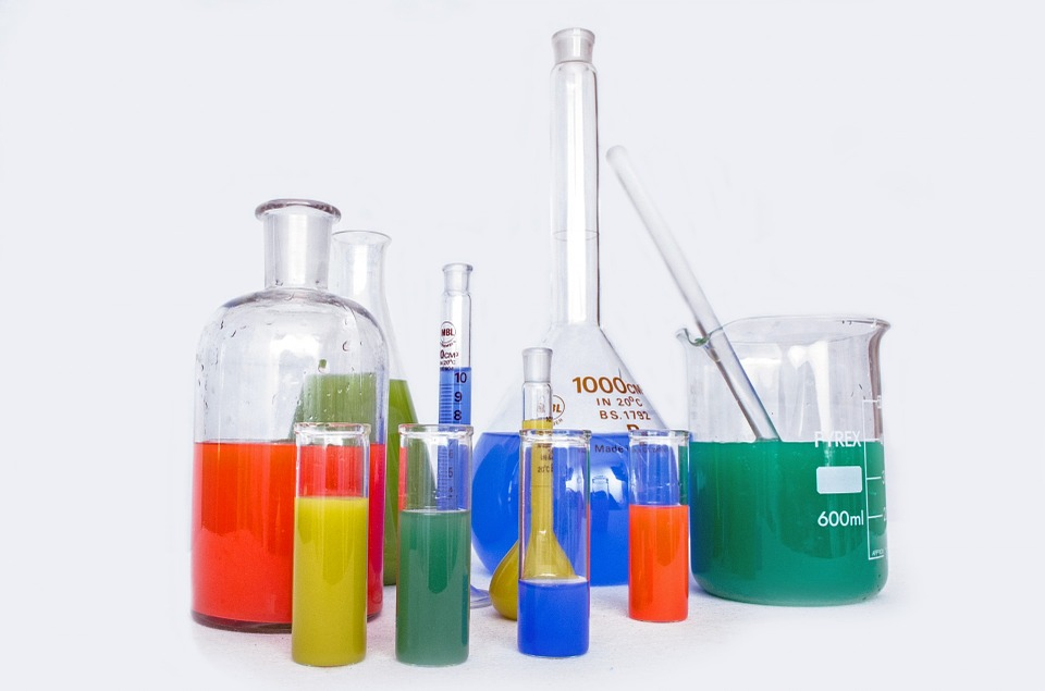 Various sized beakers with different coloured liquid inside