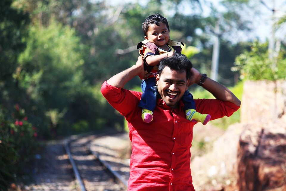 Father with infant child on his shoulders