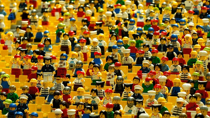 Crowd of lego figurines sitting in auditorium
